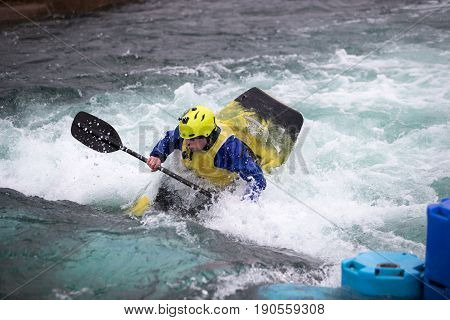 Man In Kayak About To Go Underwater
