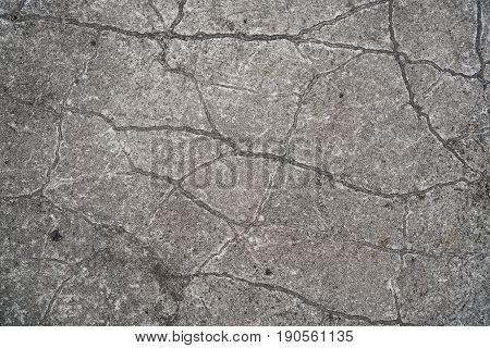 Cracks in a concrete floor on a platform