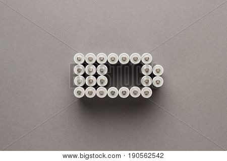 conceptual image of battery charge. battery charge level pictogram. battery level concept made of rechargeable batteries. battery level concept over gray background
