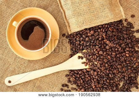 Coffee In Yellow Cup On Fabric Background.