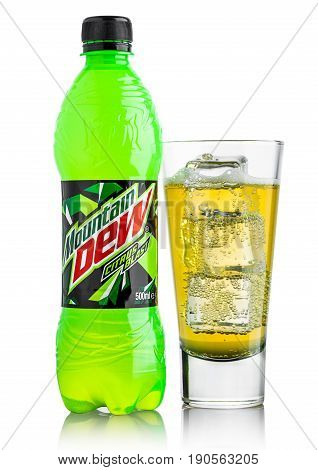 London, Uk - June 9, 2017: Bottle And Glass Of Mountain Dew Drink On Ice Isolated On White. Mountain