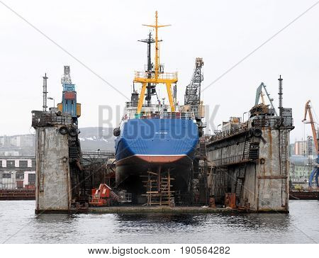 Murmansk, Russia - May 25, 2010: The ship is under repair at a floating dock