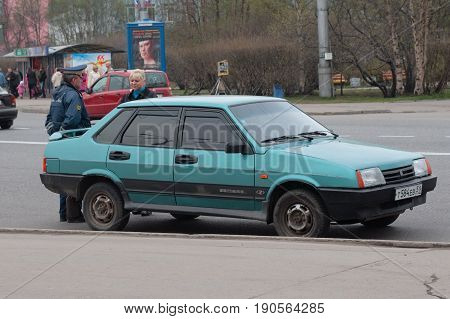 Murmansk, Russia - May 25, 2010: The policeman stopped the driver's girl