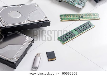 Electronic memory. Close up top view of central processing units and different data storage devices are on white desk
