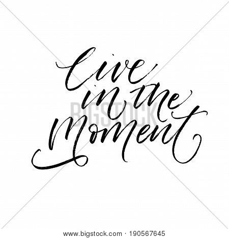 Live in the moment phrase. Ink illustration. Modern brush calligraphy. Isolated on white background.