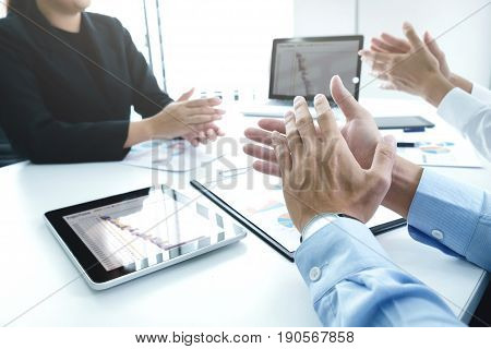 Successful Business Team Clapping After Good Deal.
