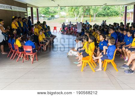 Aolfi, Niue - May 27, 2017; Niuean primary children in open air school assembly under cover of roof