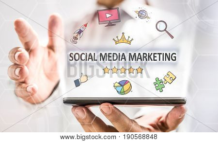 Social Media Marketing With Smart Phone On Businessman's Hand