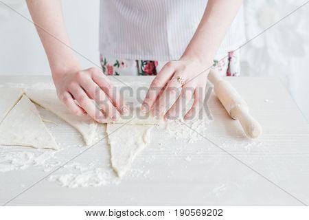 Young Beautiful Woman Preparing Homemade Croissants