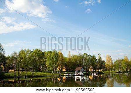 Landscape lake forest reflected bridges. Summerhouses, summer