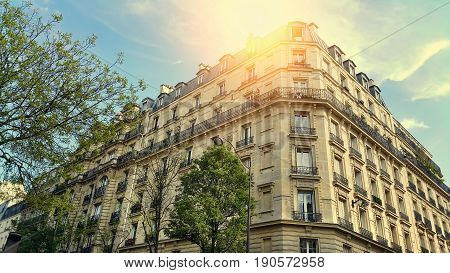 Facade of typical building with attic in Paris France