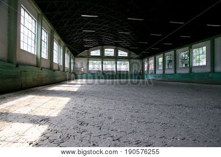 Sandy covering abandoned training arena for riders and horsemen