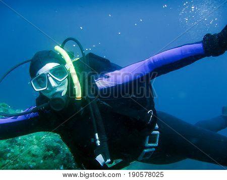 Diver Underwater. Scuba diving blue water. Diver