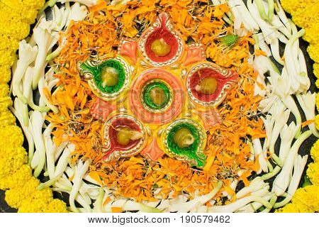 Deepabali Deepavali or Deepawali - the festival of lights is widely celebrated in India and now all over the world. Rangoli Diyas - colourful and decorated candles are lit in night to throw away darkness on this auspicious occassion.