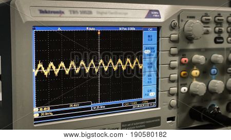 Guangzhou China - January 17 2017: Detail of an oscilloscope in a factory of electronic components.