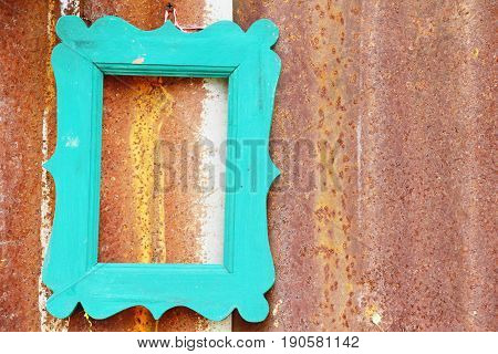 Wooden frame on old zinc background texture