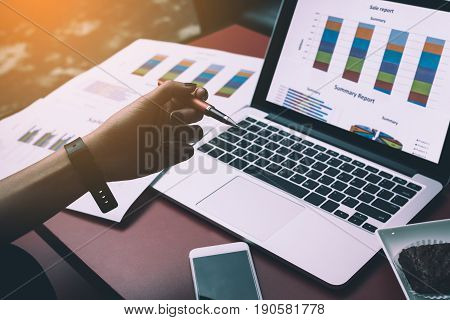 Business people analyze charts and graph revenue with modern laptop computers. Business Analysis and Strategic Concepts