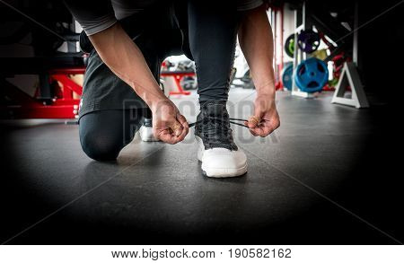 Man Tie Shoelaces One The Gym, Ready To Do Some Exercise