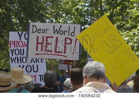 Asheville, North Carolina, USA - June 3, 2017: People hold political signs at a
