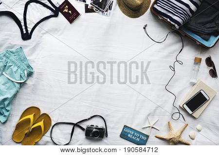 Travel objects on a bed