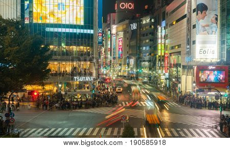 Shibuya Tokyo Japan - November 11 2016: People and traffic at Shibuya Crossing. Scramble crossing in ShibuyaTokyo is famous landmark of Tokyo for nightlife and business in Shibuya.