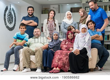 Big family together sitting at home