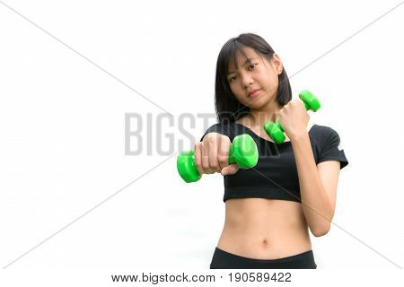 Attractive young fitness woman holding dumbbells isolated on white background.