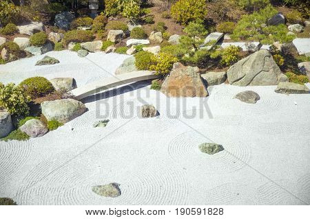 Concentric circles on the sand in the Japanese garden. contemplative garden of stones in Japanese style. Copy space for your text