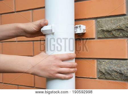 Contractor repair rain gutter downspout pipe. Roundline Guttering Guttering & Drainage.