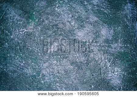 Cosmic blue and green oily spotted background. Flat lay