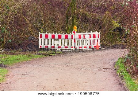 Red and White Street Barricade. Road block or construction site barrier on a road.