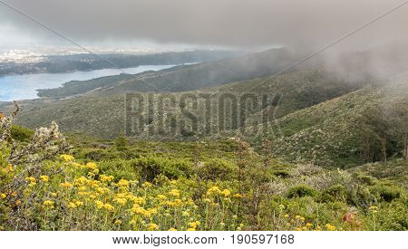 Fog Rolling In On Crystal Springs Reservoir. Sweeney Ridge, San Mateo County, California, USA.
