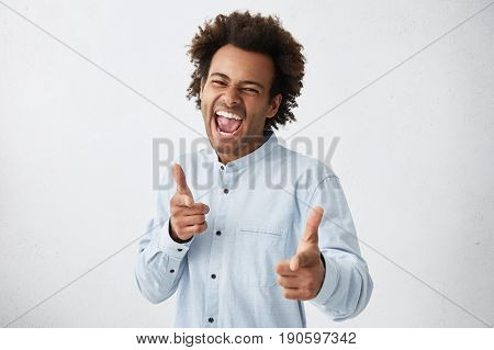 Handsome Afro American Man In White Shirt With Full Of Happiness Pointing Index Fingers At Camera Ex