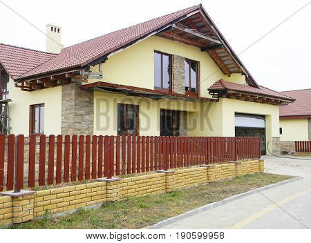 Building house construction with repair and wall renovation. Unfinished house construction with garage