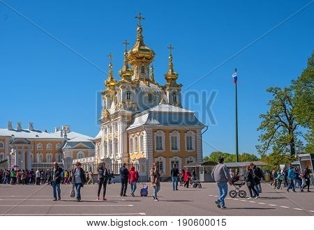 Petergof, Russia - June 5, 2017: Church of Peter and Paul. The Palace Church. The domes are gilded and richly decorated. View of the church from the side of the Palace Square.