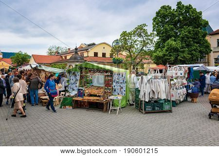 Piestany, Slovakia – May 20 2017: Unidentified People Admire And Buy Traditional Folk Product That A