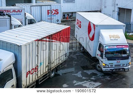 Kota Kinabalu,Sabah-May 27,2017:Poslaju Express trucks on a parking lot in Kota Kinabalu,Sabah,Malaysia.Pos Laju is the leading courier company & has the widest network coverage & the largest courier fleet in Malaysia.