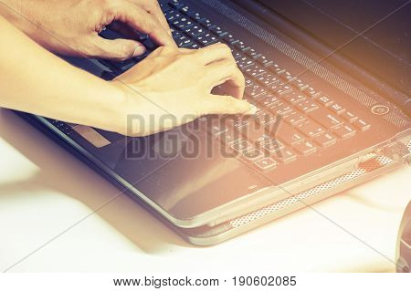 Young woman with laptop on the table.