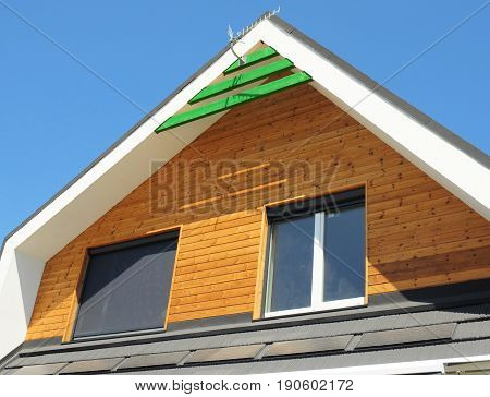 House Blinds Sun Protection Exterior. Windows in New Modern Passive House Facade Wooden Wall with Shutters Closed and Opened Outdoors. Protection Against Sun and Heat as Energy Saving.