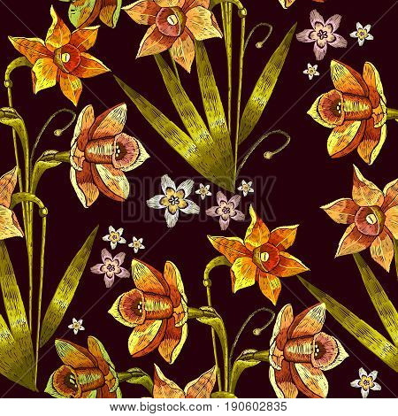 Narcissus embroidery seamless pattern. Beautiful daffodils yellow narcissus embroidery on black seamless background. Template for clothes textiles t-shirt design