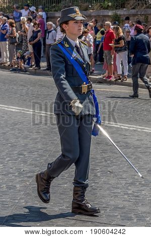 ROME ITALY - JUNE 2 2017: Military parade at Italian National Day. Woman commander in front. Picture is taken between Piazza Venezia and Teatro di Marcello.
