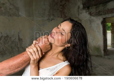 Young woman being abused trying to defend herself