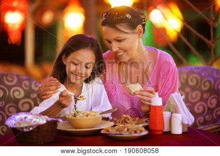 Mother and daughter eating in a restaurant