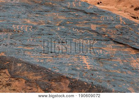Petroglyphs Along The Rock Wall
