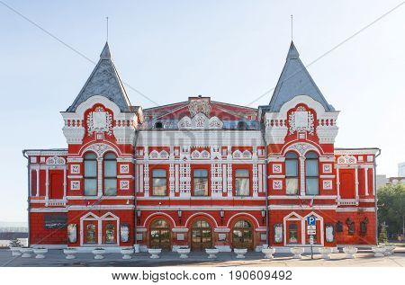 Samara, Russia - June 2017 - Facade of the drama theater in Samara in Russia. Town landscape with historic theater and blue sky