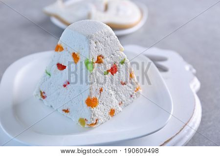 Traditional curd Easter cake with candied fruits on white plate