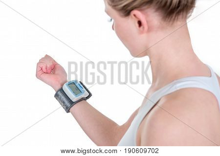 Woman checking blood pressure. Measurement of heart rate and pressure. Closeup view isolated on white background