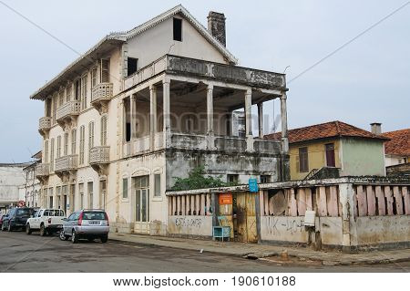 SAO TOME, SAO TOME AND PRINCIPE - FEBRUARY 1, 2017: Colonial buildings in Sao Tome city during the evening hours on February 1, 2017 in Sao Tome and Principe, Africa