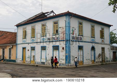 SAO TOME, SAO TOME AND PRINCIPE - FEBRUARY 1, 2017: People in front of colonial buildings in Sao Tome city during the evening hours on February 1, 2017 in Sao Tome and Principe, Africa