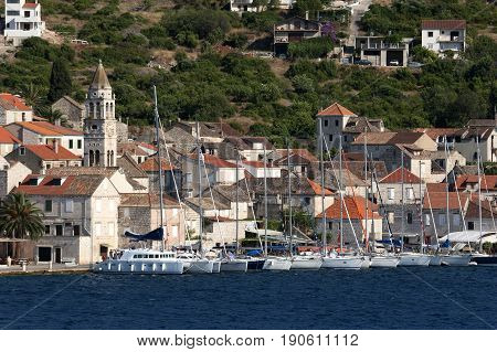 White sailing boats moored in harbor of Vis in Croatia